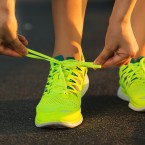 Running shoes. Barefoot running shoes closeup. Female athlete ty